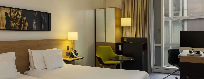 Die Betten im Zweibettzimmer bietet den Gästen hohen Schlafkomfort