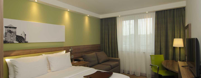 Entspannen Sie im gemütlichen Zimmer mit kostenfreiem WLAN