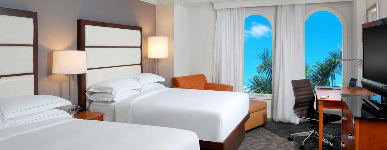 Bei einem Aufenthalt zu zweit steht Ihnen ein bequemes Zimmer mit zwei Queen-Size-Betten zur Verfügung