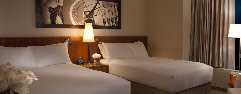 Die bequemen Betten im Zimmer bieten Ihnen hohen Schlafkomfort