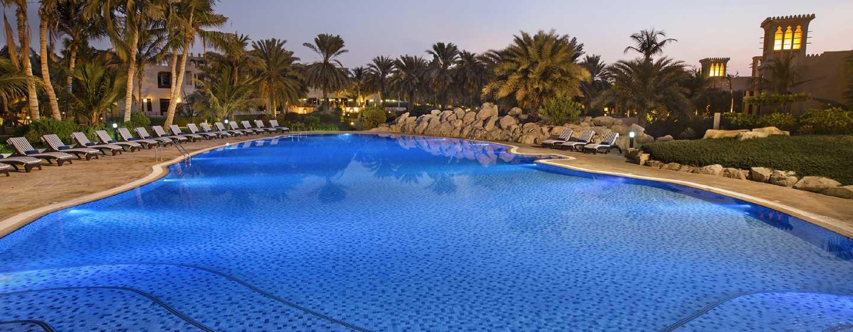 Hilton Al Hamra Beach& Golf Resort Hotel, Ras Al Khaimah, VAE– Swimmingpool Sunset