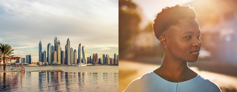 LXR Hotels & Resorts – Blick auf die Skyline und lachendes Mädchen im Tageslicht