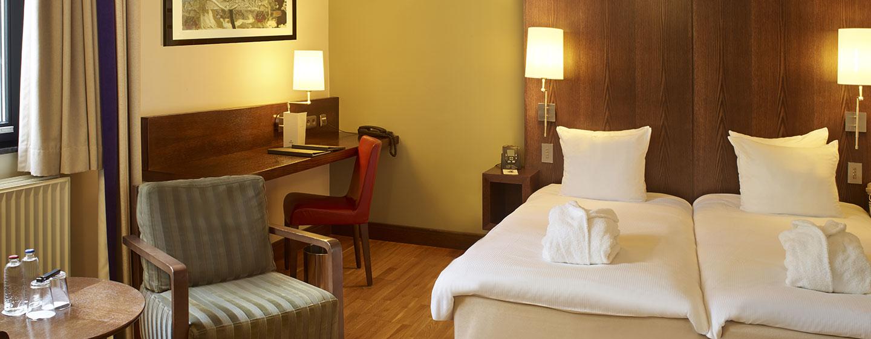 Die bequemen Betten im Hilton Brüssel werden Ihnen viel Schlafkomfort bieten