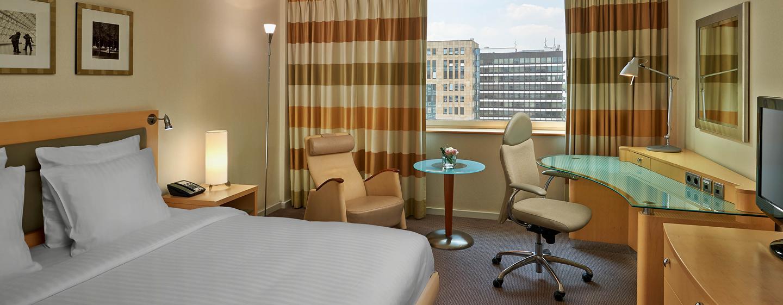 Das moderne Zimmer bietet Ihnen dank King-Size-Bett viel Schlafkomfort