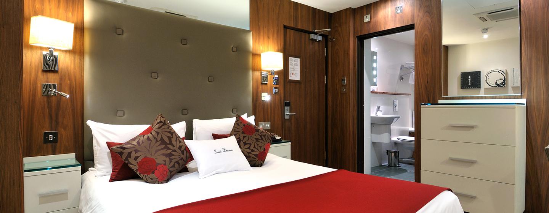 Einen erholsamen Schlaf können Sie in diesem Deluxe Doppelzimmer genießen