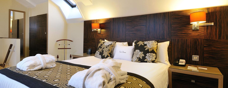 Das Schlafzimmer des Apartments befindet sich auf einer separaten Etage