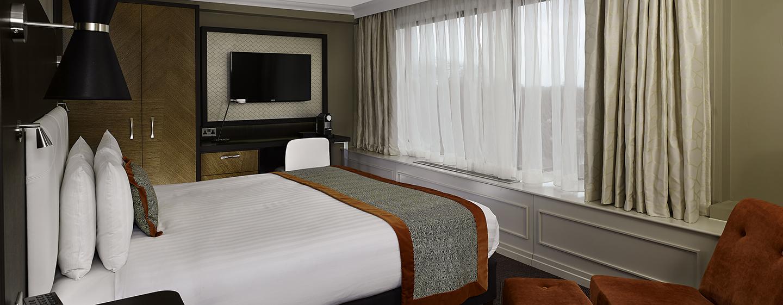 Im Deluxe Zimmer des Hotels können Sie im großen King-Size-Bett entspannen